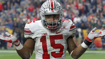 Ohio State running back Ezekiel Elliott (15) gestures as he celebrates his fourth touchdown of the game against Notre Dame  during the second half of the Fiesta Bowl NCAA College football game, Friday, Jan. 1, 2016, in Glendale, Ariz.  (AP Photo/Ross D. Franklin)