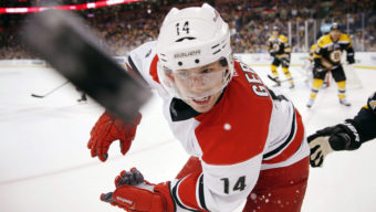 10ThingstoSeeSports - Carolina Hurricanes' Nathan Gerbe (14) battles for the puck in the first period of an NHL hockey game against the Boston Bruins in Boston, Saturday, March 15, 2014. (AP Photo/Michael Dwyer, File)