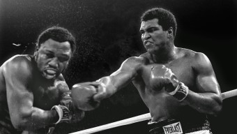 Spray flies from the head of challenger Joe Frazier as heavyweight champion Muhammad Ali connects with a right in the ninth round of their title fight in Manila, Philippines, October 1, 1975.  Ali won the fight on a decision to retain the title.  (AP Photo/Mitsunori Chigita)