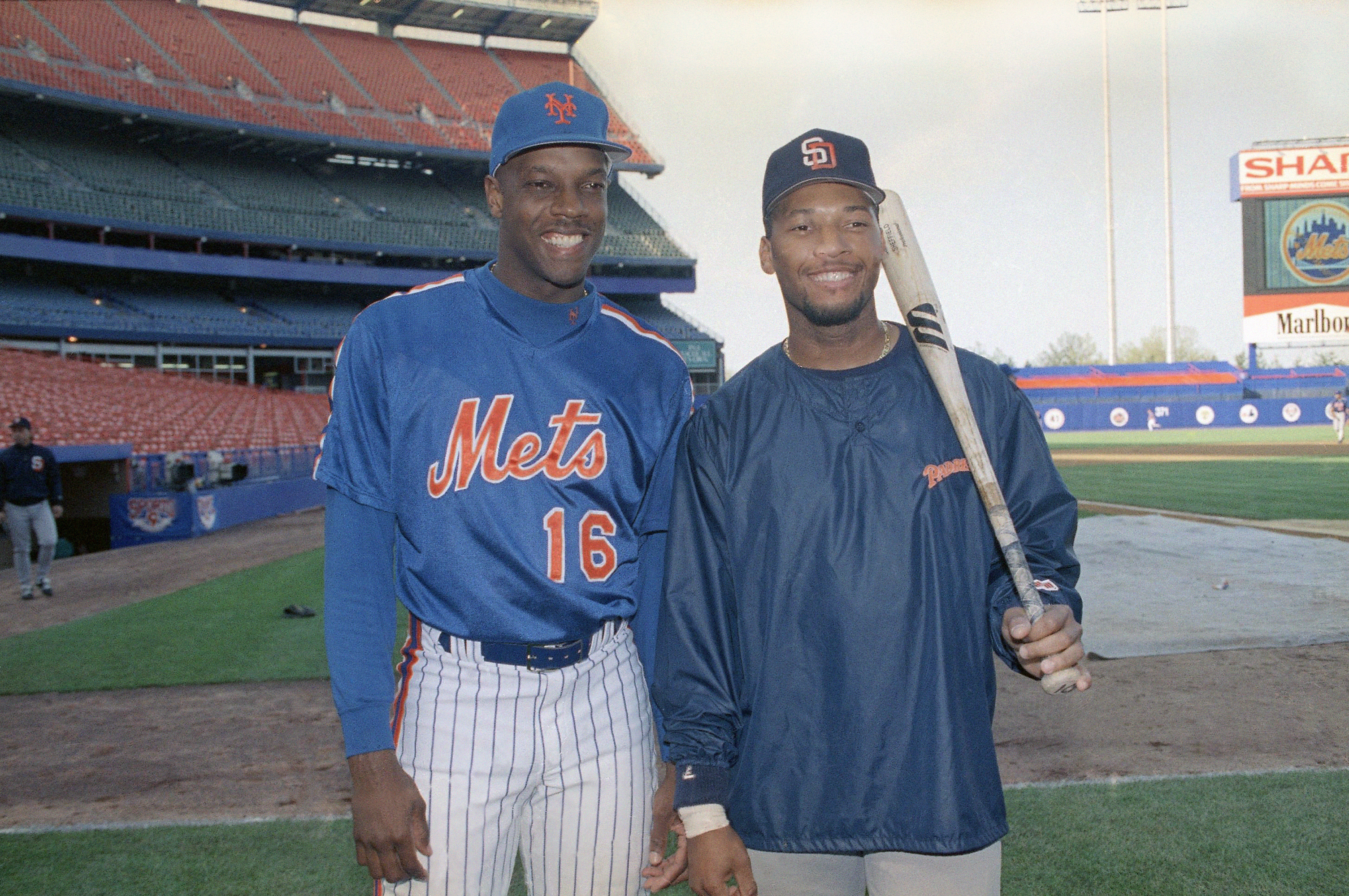 Dwight Gooden, left, pitcher for the New York Mets and his nephew Gary Sheffield, third baseman for the San Diego Padres, share a laugh before their teams get together and play at Shea Stadium in New York, Monday, May 11, 1992. Gooden will take the mound and Sheffield will play third. (AP Photo/Richard Harbus)