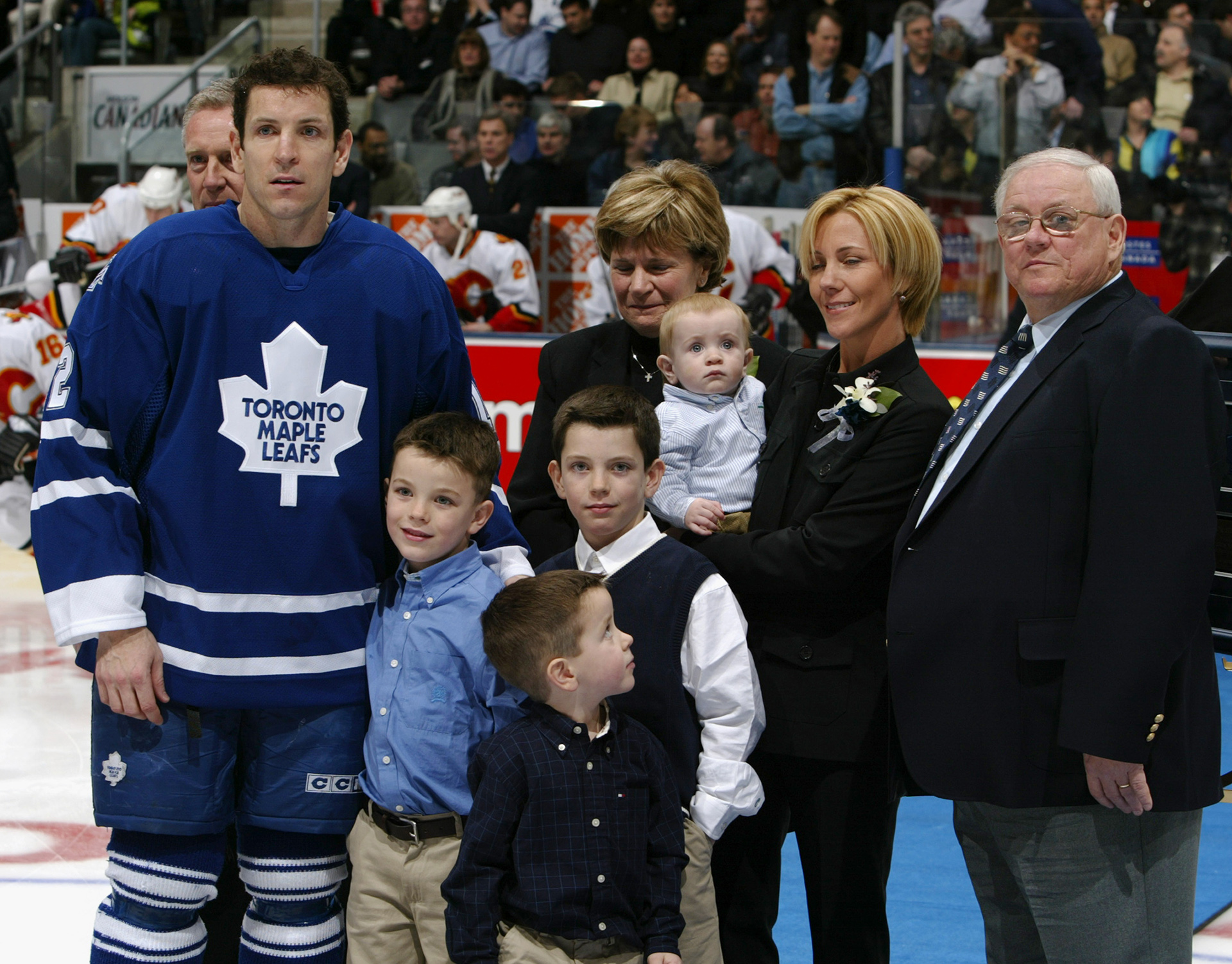 TORONTO - JANUARY 13:  Tom Fitzgerald #12 of the Toronto Maple Leafs poses with his family during a ceremony before the game against the Calgary Flames at Air Canada Centre on January 13, 2004 in Toronto, Ontario. The Leafs defeated the Flames 4-1.(Photo By Dave Sandford/Getty Images)