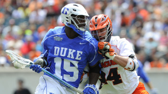 May 27, 2013; Philadelphia, PA, USA; Duke Blue Devils midfielder Myles Jones (15) dodges to the goal against Syracuse Orange midfielder Steve Ianzito (24) during the second quarter of the 2013 NCAA Division I Men's Lacrosse Championship Game at Lincoln Financial Field.  Mandatory Credit: Rich Barnes-USA TODAY Sports