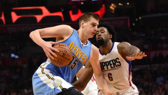 Mar 27, 2016; Los Angeles, CA, USA; Denver Nuggets center Nikola Jokic (15) is defended by Los Angeles Clippers center DeAndre Jordan (6) during an NBA game at Staples Center. Mandatory Credit: Kirby Lee-USA TODAY Sports