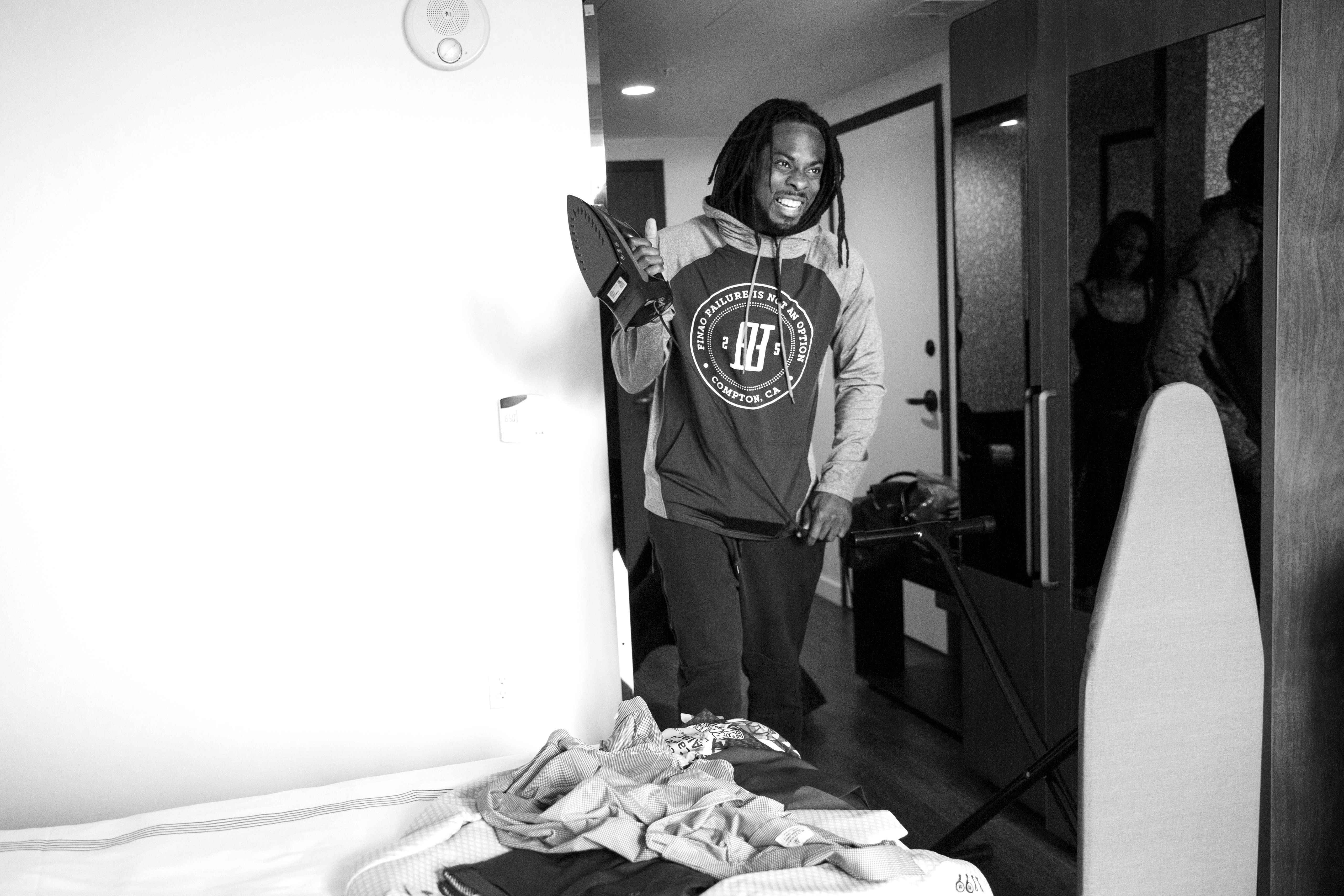 Richard Sherman gets ready in his hotel room before the Richard Sherman Celebrity Softball Gala on July 9, 2016 in Seattle, WA. (Photo by Taylor Baucom/The Players' Tribune)
