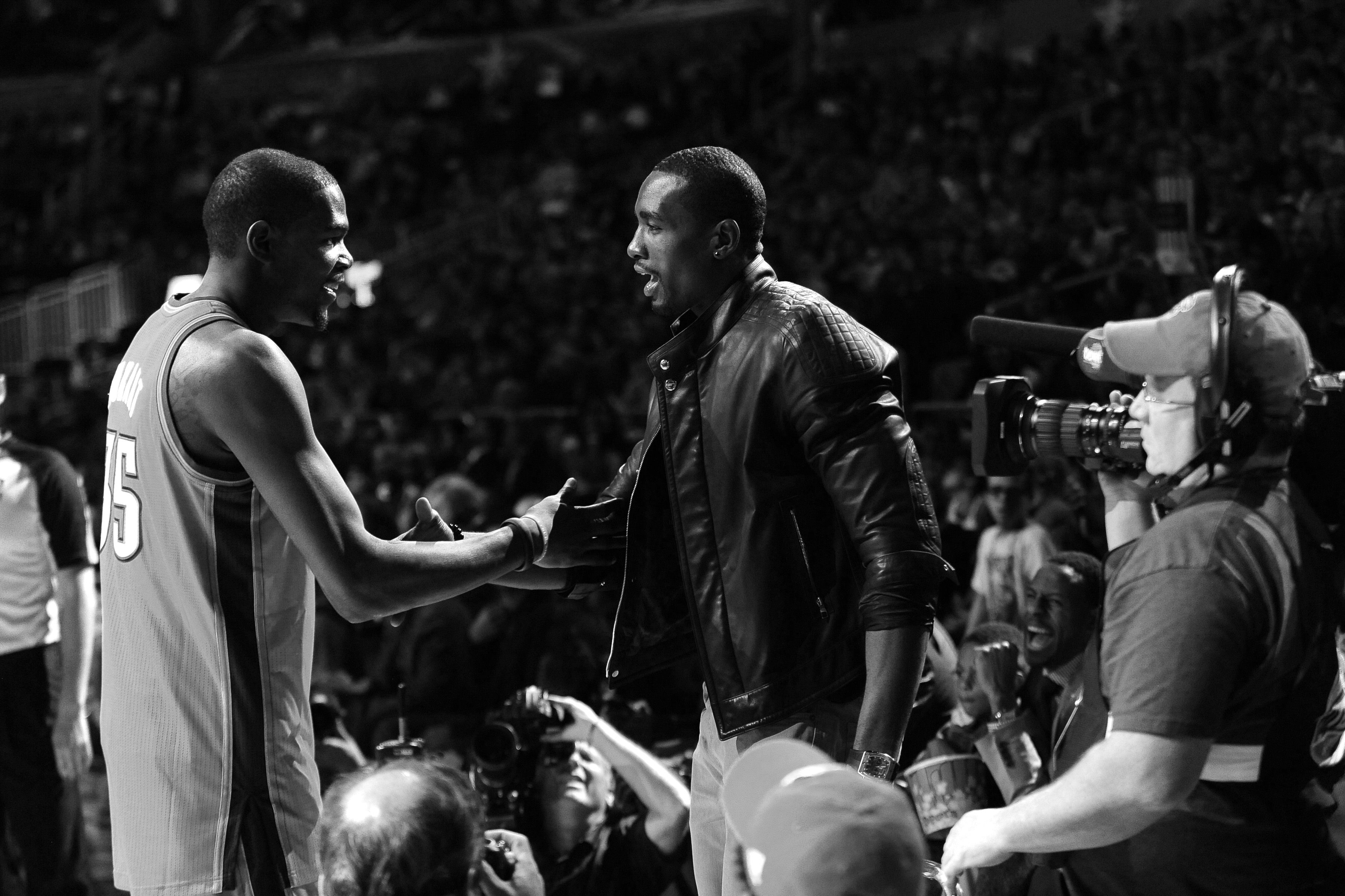 ORLANDO, FL - FEBRUARY 25: Kevin Durant #35 and Serge Ibaka #9 of the Oklahoma City Thunder shake hands during the Foot Locker Three-Point Contest as part of 2012 All-Star Weekend at the Amway Center on February 25, 2012 in Orlando, Florida. NOTE TO USER: User expressly acknowledges and agrees that, by downloading and/or using this photograph, user is consenting to the terms and conditions of the Getty Images License Agreement. Mandatory Copyright Notice: Copyright 2012 NBAE (Photo by Noah Graham/NBAE via Getty Images)