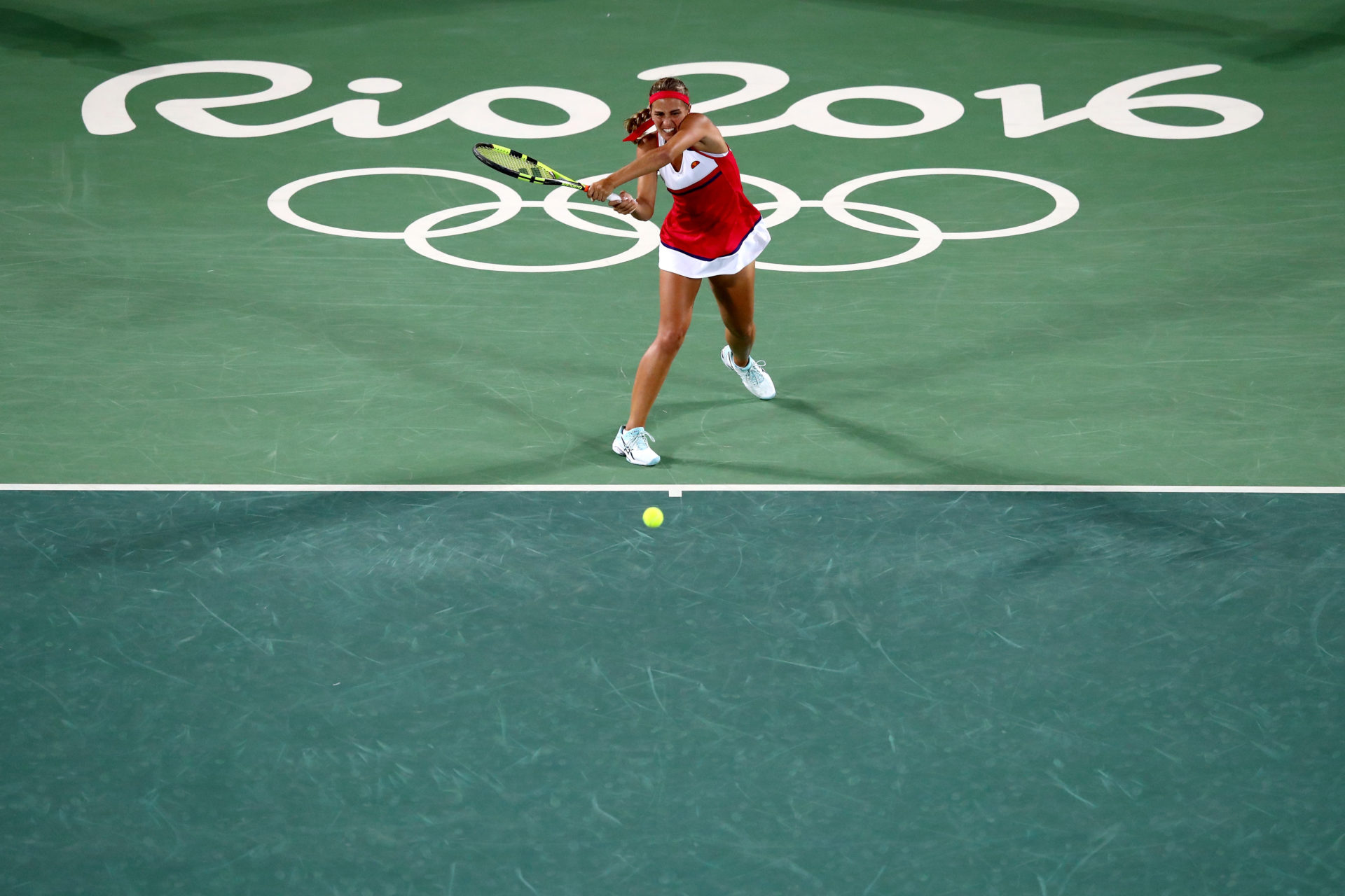 RIO DE JANEIRO, BRAZIL - AUGUST 13: Monica Puig of Puerto Rico returns a shot against Angelique Kerber of Germany during the Women's Singles Gold Medal Match on Day 8 of the Rio 2016 Olympic Games at the Olympic Tennis Centre on August 13, 2016 in Rio de Janeiro, Brazil. (Photo by Dean Mouhtaropoulos/Getty Images)