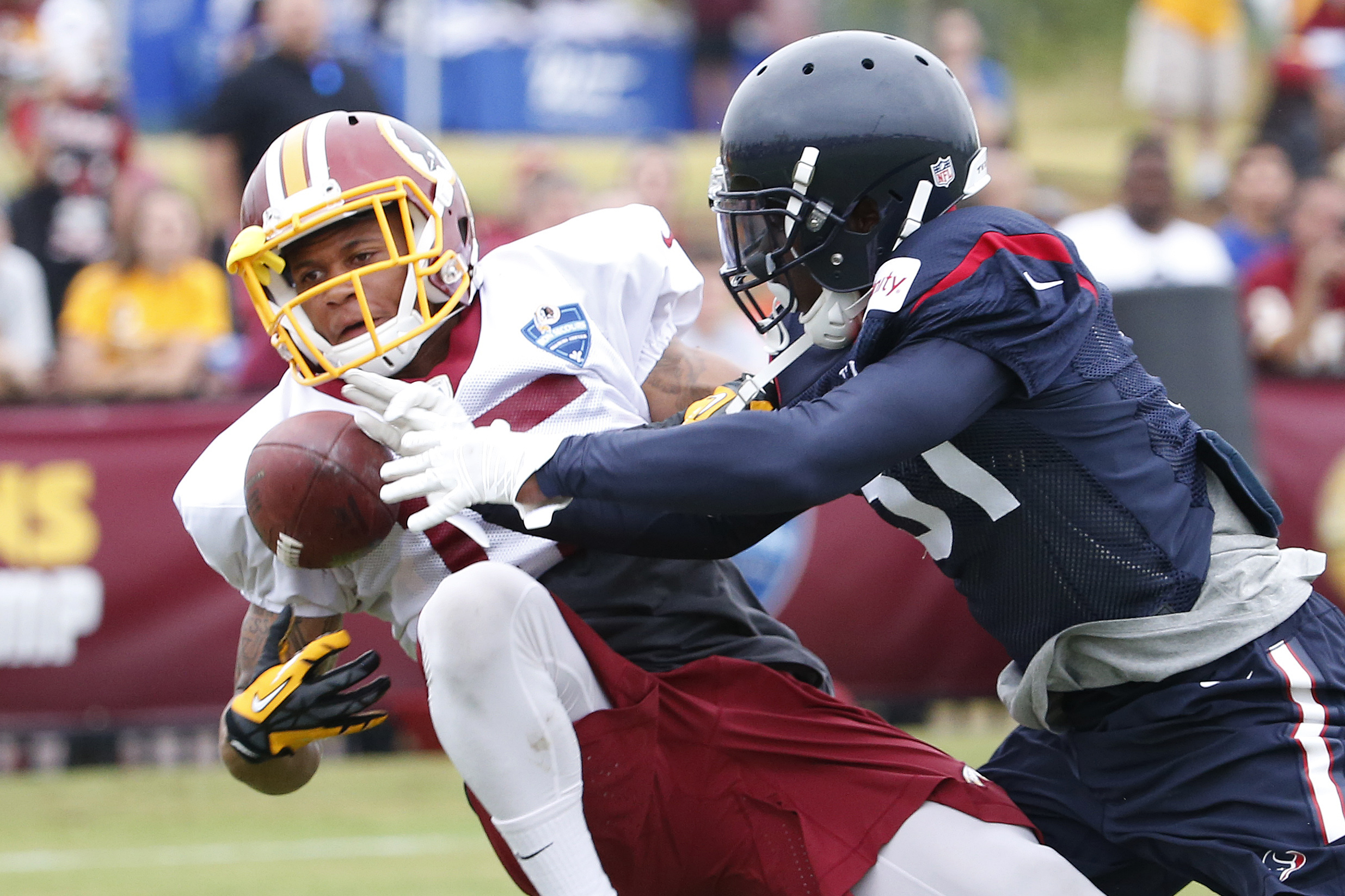 Aug 7, 2015; Richmond, VA, USA; Washington Redskins wide receiver Colin Lockett (15) attempts to catch the ball in front of Houston Texans defensive back Charles James (31) during morning practice as part of day eight of training camp at Bon Secours Washington Redskins Training Center. Mandatory Credit: Amber Searls-USA TODAY Sports